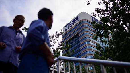 The ZTE logo is seen on a building