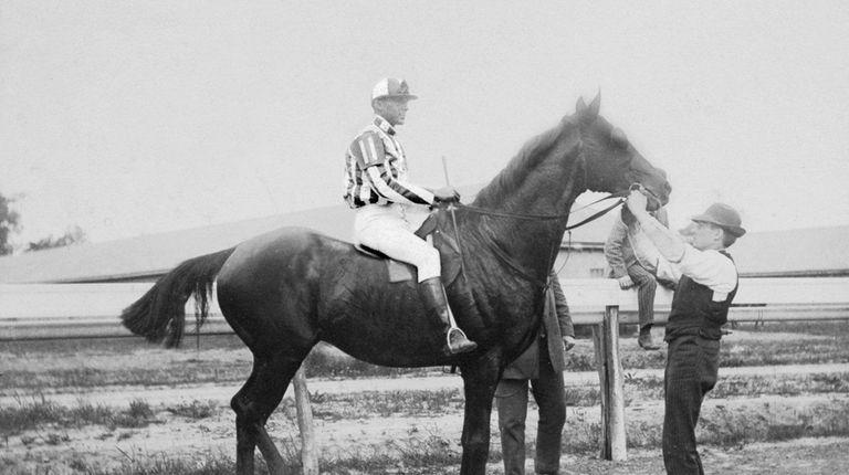 Issac Murphy, on the horse, won three Kentucky