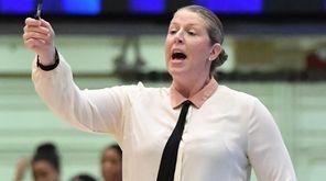 New York Liberty head coach Katie Smith directs