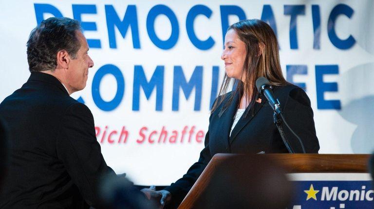 Suffolk Legis. Monica Martinez, right, shakes hands with