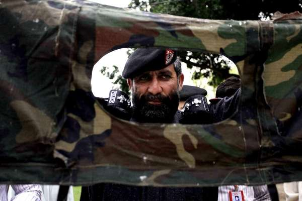 A Pakistani police officer shows part of a