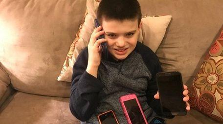 Kidsday reporter Matthew Vilbig enjoys his hand-me-down phones.