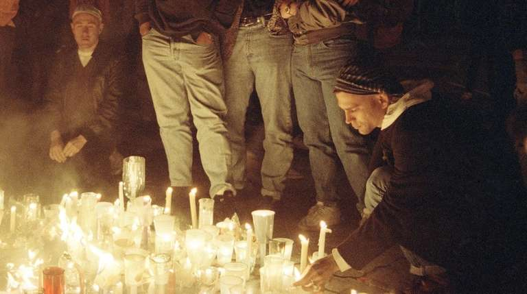 Mourners at an AIDS candlelight vigil in 1991.