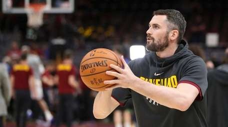 Cleveland Cavaliers center Kevin Love shoots before Game