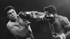 Floyd Patterson lands a hard right on Muhammad