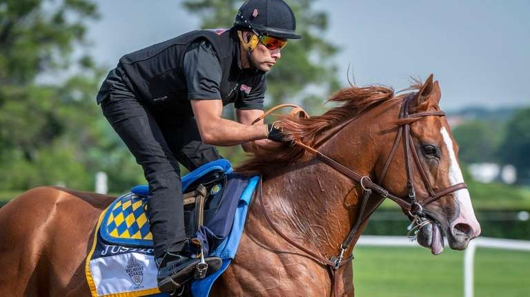 Justify works out with exercise rider Humberto Gomez