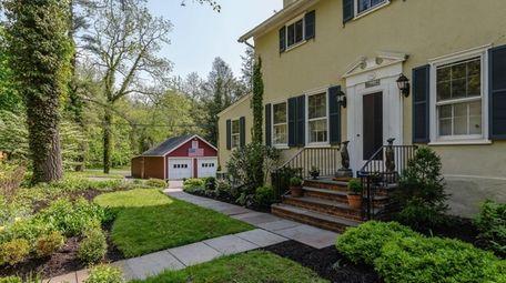 The four-bedroom, 4.5-bath farmhouse Lloyd Harbor house offers