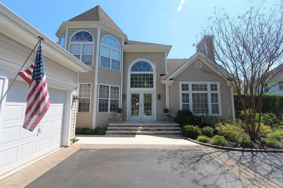This Smithtown Colonial includes five bedrooms and 2