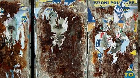 Torn electoral posters for the March 4 general