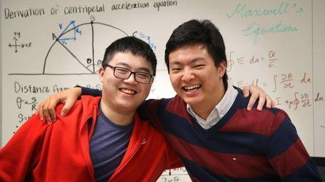 Jericho High School seniors Andrew Fang, 17, left,