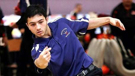 Smithtown's Eric Bholan during the dual match against