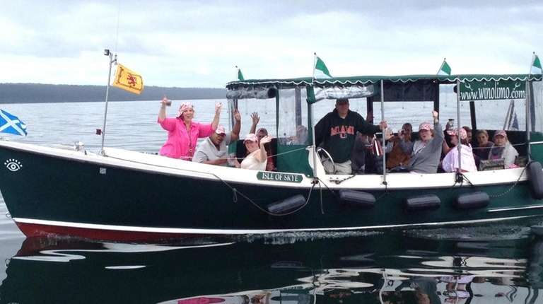 A Water to Wine boat tour travels on
