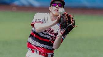 Center Moriches' Dylan Bryant catches a fly ball