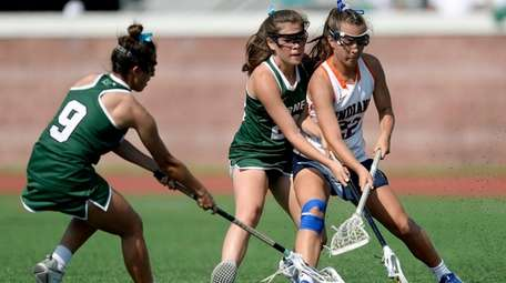Manhasset's Shea Garcia, right, tries to shield Fayetteville-Manlius'