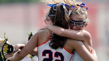 Manhasset's Shea Garcia (22) gets a hug from
