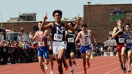 Northport's Elijah Claiborne crosses the finish to take