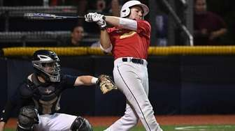 Nassau outfielder Mike Handal (Garden City) hits an