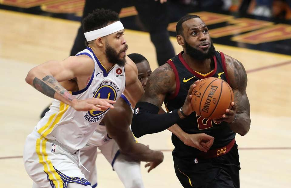 The Cavaliers' LeBron James goes to the basket
