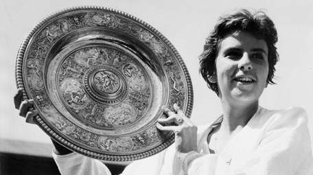 Maria Bueno of Brazil holds up the trophy