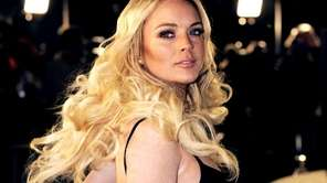 Lindsay Lohan poses as she arrives at the