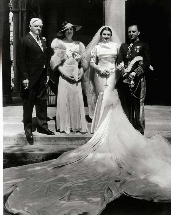 Natalie Coe poses at her wedding at her
