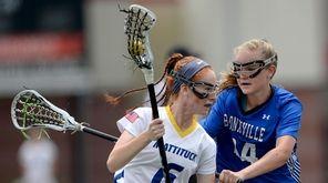 Mattituck-Southold's Maddie Schmidt, left, drives toward the goal