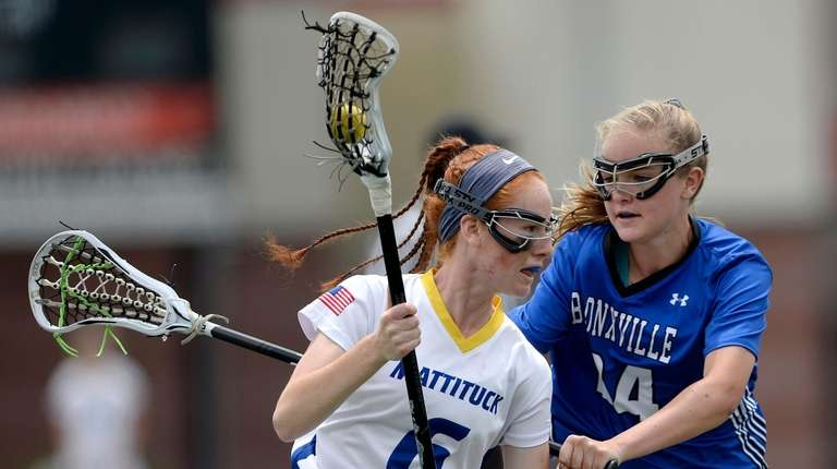 Mattituck-Southold's Maddie Schmidt, left, drives toward the goal