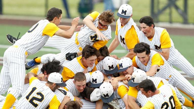 Massapequa teammates celebrate their victory over Baldwinsville in