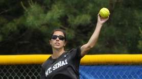 Mt. Sinai's Samantha Valenti throws from center field