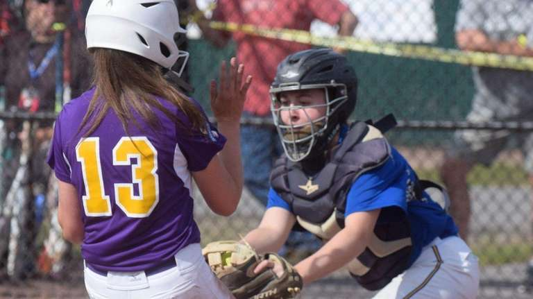 East Meadow's Sara Polansky, right, tags out Ballston