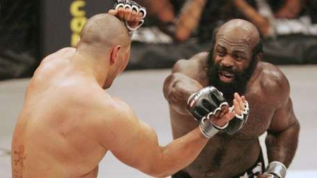 Kimbo Slice, right, throws a punch at James