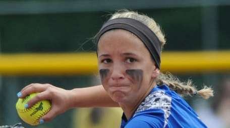 East Meadow's Jenna Laird throws to first against