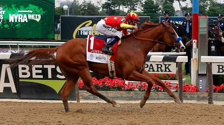 Justify crosses the finish line to win the