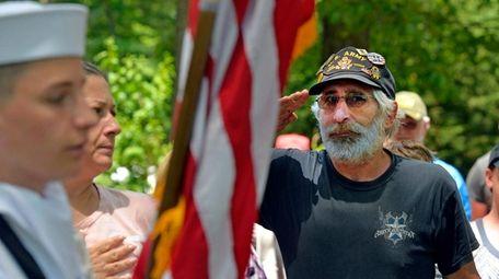 U.S. Army veteran John Damato of Levittown salutes