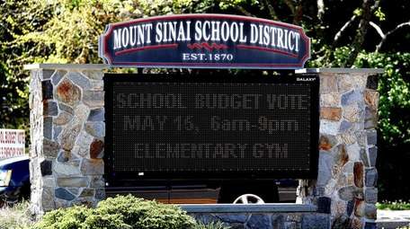 A budget referendum message appears on an electric