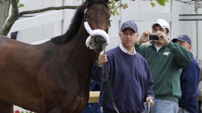 Trainer Todd Pletcher leads his Kentucky Derby winner