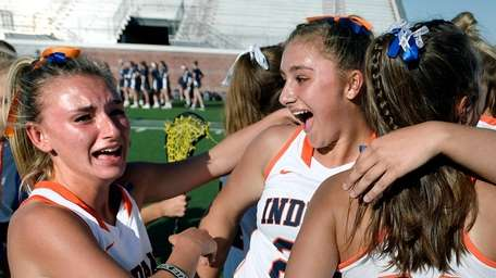 Manhasset's Alexandra Petras, center, celebrates the state title