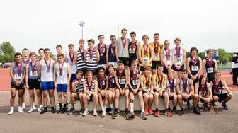 All of the boys 4x800 relay teams pose