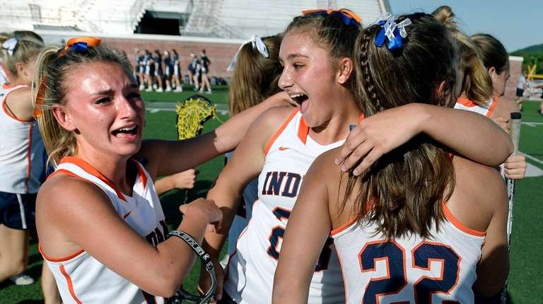Manhasset's Alexandra Petras celebrates with Lindsay Giacobbe, left,