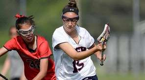 Cold Spring Harbor's Emily Weld, right, chases a