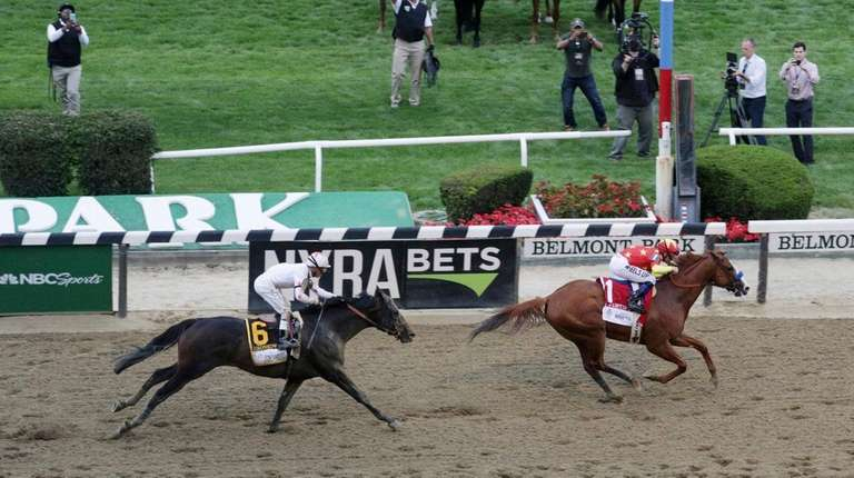 Justify, crosses the finish line to win the