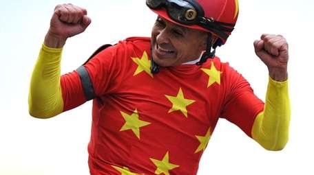 Jockey Mike Smith reacts after riding Justify to