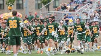 Ward Melville run onto the field to celebrate