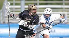 Islip Buccaneers Mike Bienkowski is stick checked by