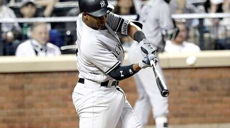 Yankees third baseman Miguel Andujar connects for a