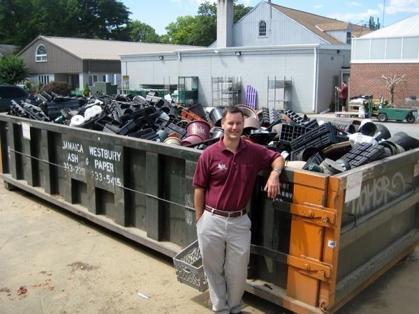 Stephen Hicks show off a dumpster full of