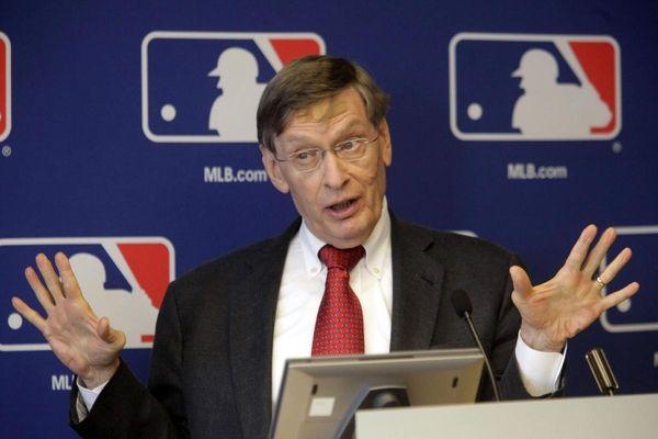 Baseball commissioner Bud Selig gestures as he speaks