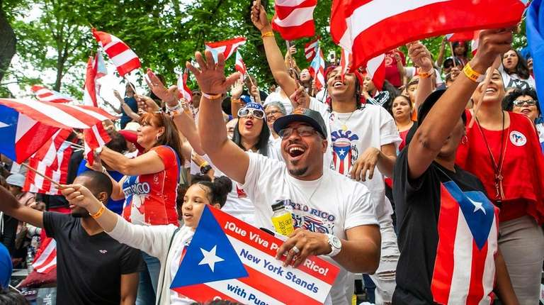 Onlookers cheer at the National Puerto Rican Day
