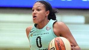 Liberty guard Marissa Coleman dribbles the ball up