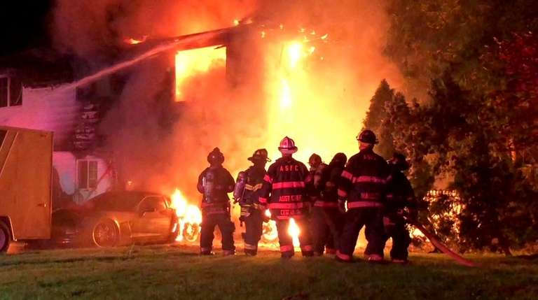Firefighters respond to a house fire early Monday